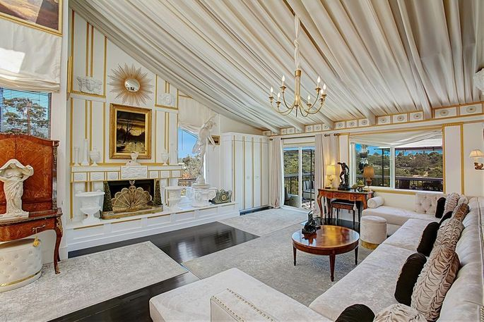 Living room with cathedral ceilings and picture windows