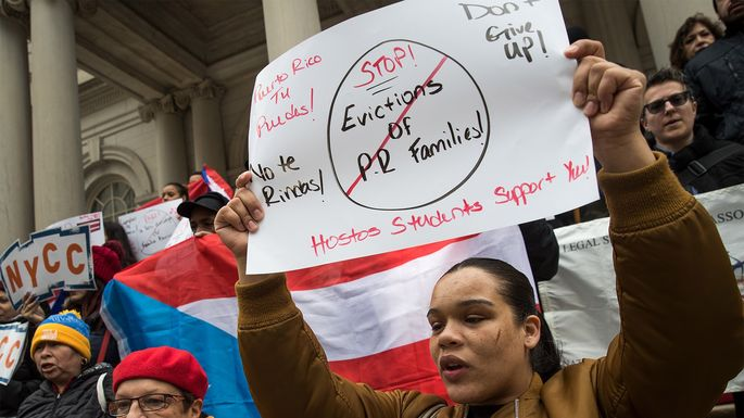 Activists rally at City Hall in New York City in support of Puerto Ricans displaced by Hurricane Maria, as FEMA hotel vouchers are set to expire.