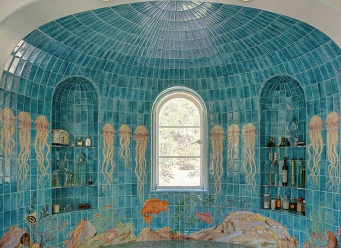 Tile work depicting sea life in the bathroom