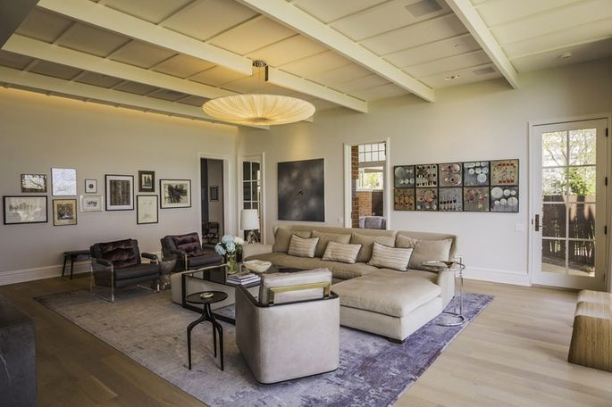 The family room, at one end of the main floor, has traditional molding, white painted steel beams, white oak floors and a clean, open, airy aesthetic.