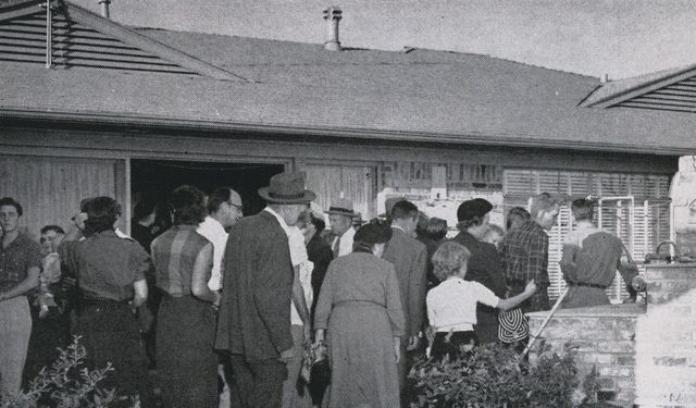 Visitors on the patio of Howdy Howard's Holiday Home in Dallas, TX, during an open house in late 1952. Originally published in the National Real Estate and Building Journal, March 1953. (NAR Archives)
