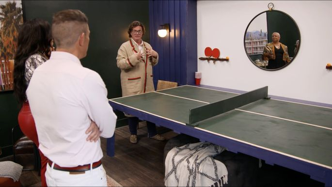 Chris Goddard's wall folds down into this cool pingpong table.