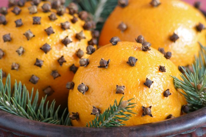 Make a pomander with cloves and an orange.