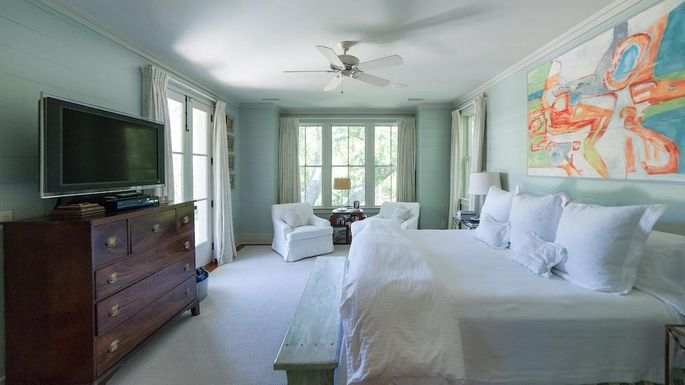 The old bedroom looked crowded with too much furniture.