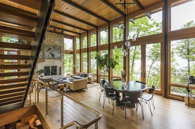 Mr. Byker says the home is inspired by Japanese design, as well as contemporary homes in the Northwest. Walls of glass overlooking the lake open to the outdoor decks.
