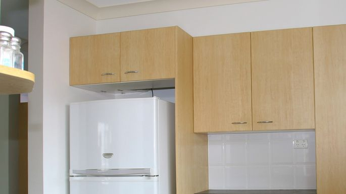 Bridge cabinet over refrigerator