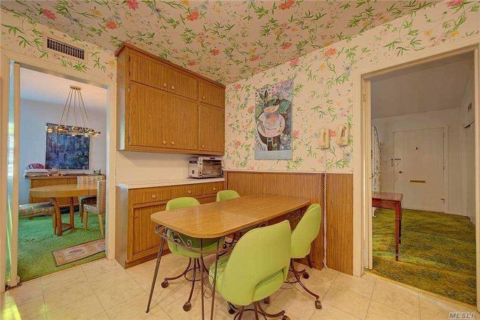 Kitchen with wallpaper on the ceiling