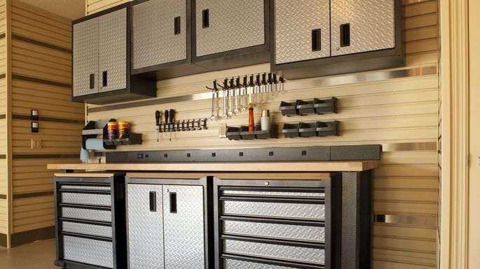 Cabinets and rolling table in garage workspace