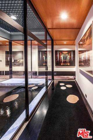 Jerry bruckheimer lists a mid century modern in l a for Koi pool thornton