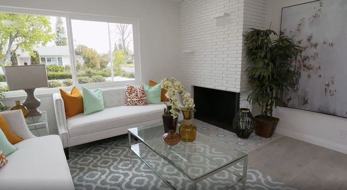 Anstead and El Moussa save money by skipping the tile on this fireplace.