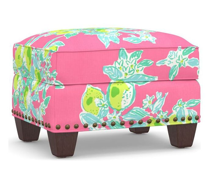 Pair this footstool with a lime-green wingback chair.