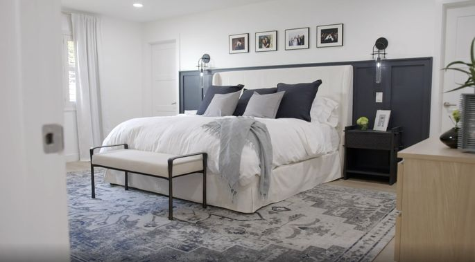 Drew and Jonathan Scott knew dark wainscoting would make this bedroom look modern and bold.