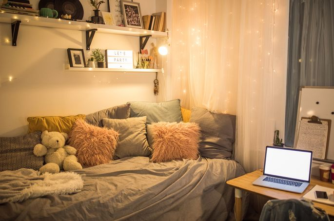 A mix of string lights can add a cozy ambiance to your room.