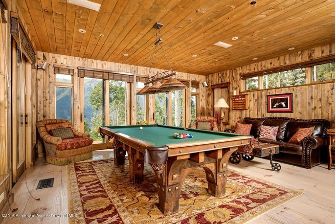 Wood-paneled game room