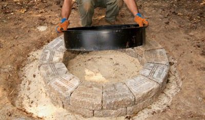 Use the liner as a guide for building your fire pit.