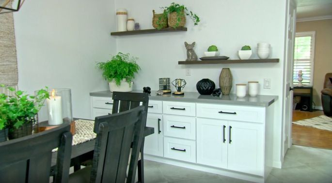 Anstead wisely incorporated a row of cabinets in the dining room for added storage during this renovation.