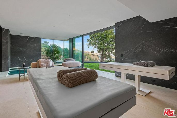 Spa with massage tables and plunge pools
