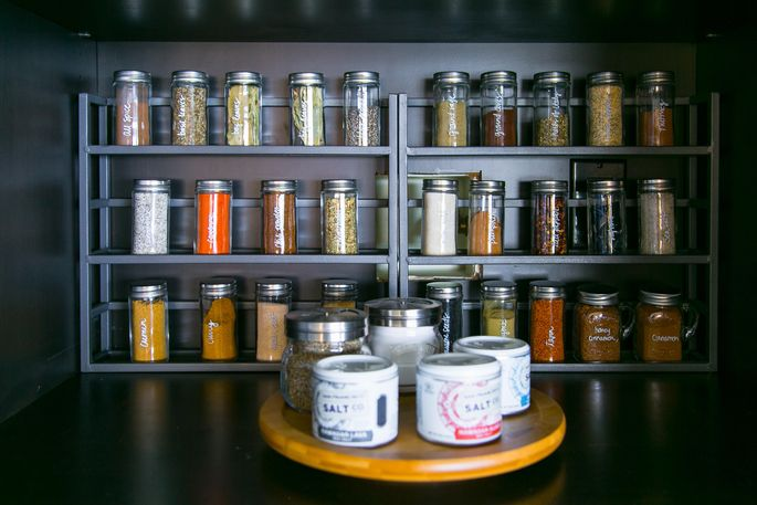 A rack of spices in matching jars adds a sense of calm to your pantry.