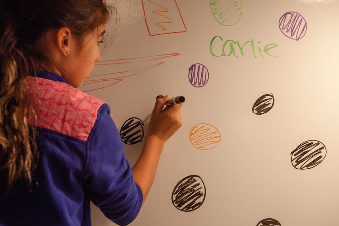 The Khan family's teen space has a wall-sizedry erase board.