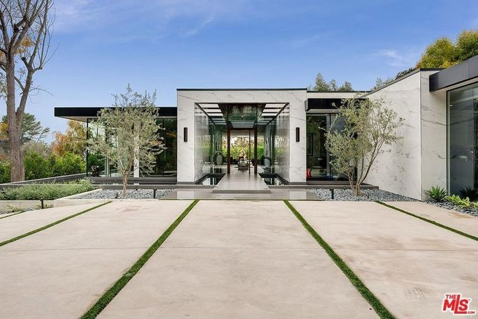Dramatic entry with a moat and pivot door