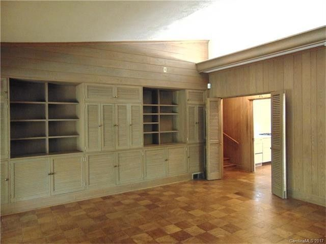 The built-in cabinets were a unique part of the architecture, but the wood paneling had to go.