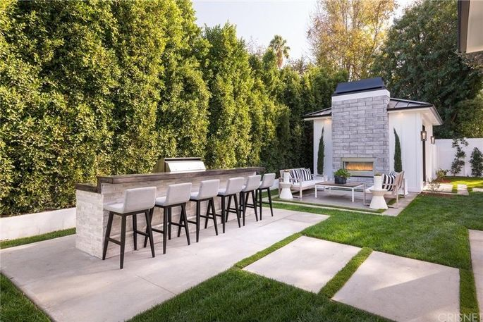 Outdoor fireplace and bar seating