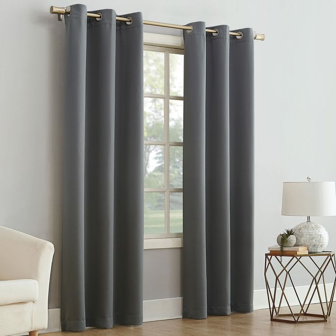 Blackout curtains offer a pop of color and privacy at night.