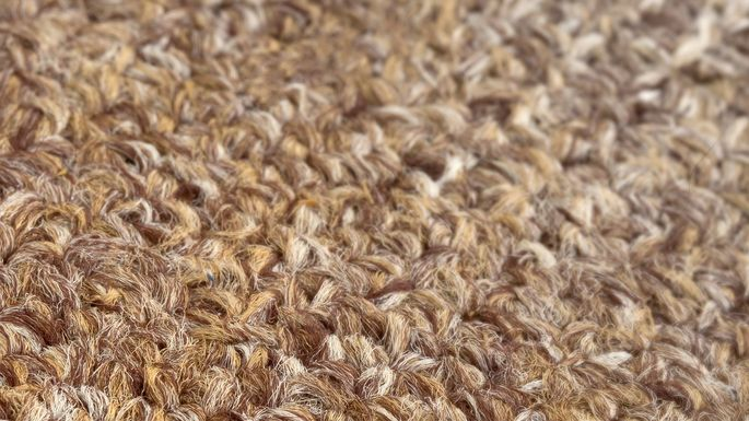 Looped, or Berber,fibers are sturdy and suited for high-traffic areas.