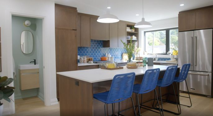 The cabinets may be dark, but this kitchen now looks modern.