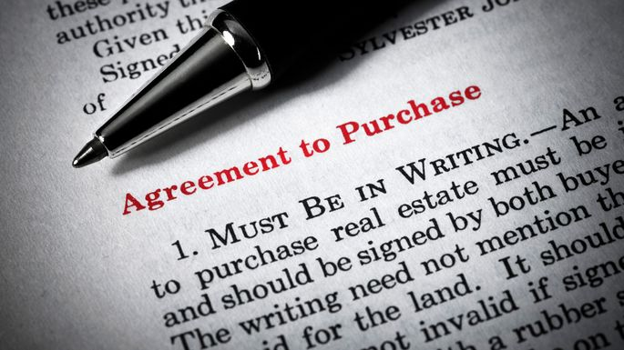 an agreement to purchase with a pen