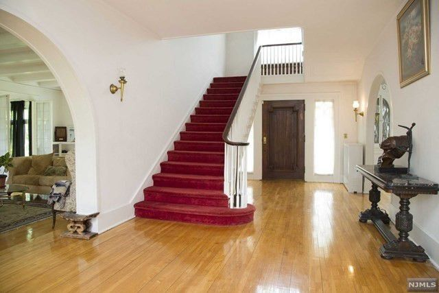 Beautiful hardwood floors can be found in the entryway and throughout the home.