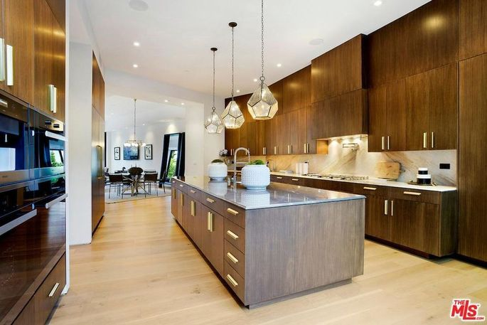 A spacious kitchen complete with a center island