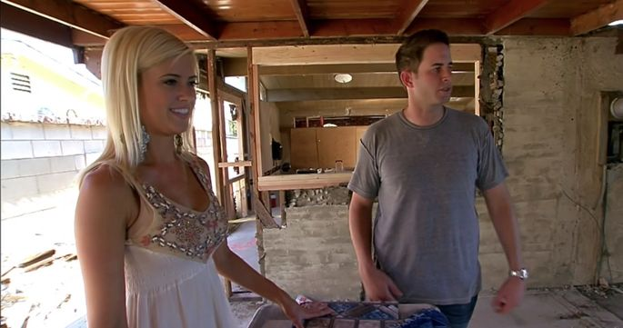 "Christina and Tarek El Moussa, who were married at the time, reviewing design choices in Season 1 of ""Flip or Flop"""