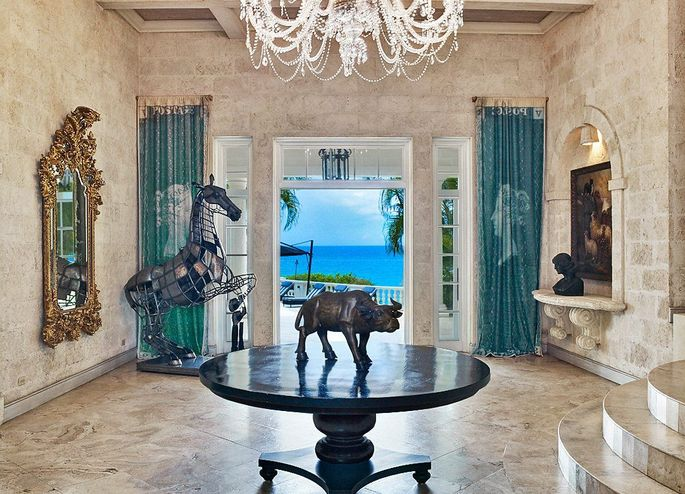 A grand foyer looking out to the sea