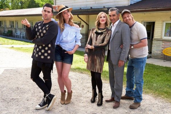 """""""Schitt's Creek"""" cast members in front of the Rosebud Motel, as it's known on the show."""
