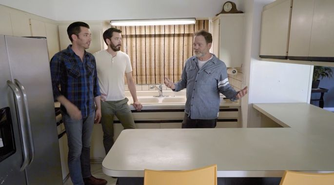 Rainn Wilson shows Drew and Jonathan Scott how much work needs to be done in the kitchen.