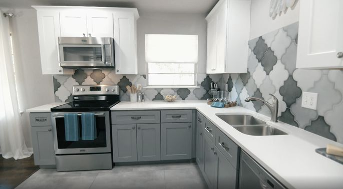 Gray and whites finishes make this kitchen look both large and chic.