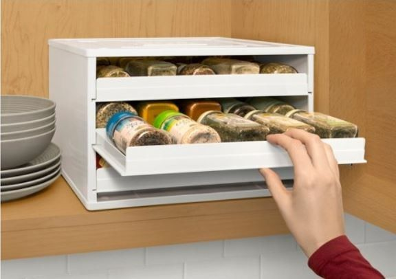 This spice rack will fit inside a cabinet or on a shelf.