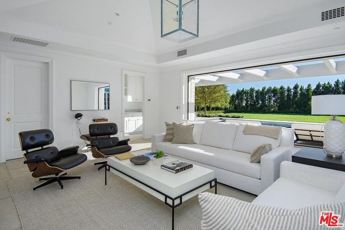 The living room opens out to the yard.