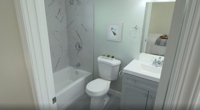 This bathroom is small, but clean and bright.