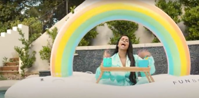 Lilly Singh shoots some video in her new pool.