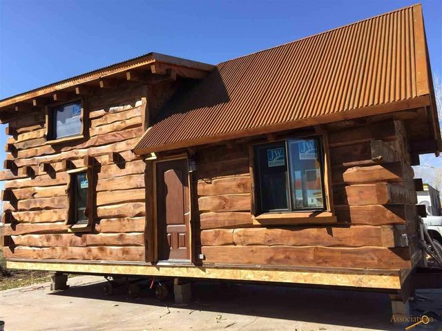 This tiny log cabin just needs a little land to sit on for Log cabin cost per square foot
