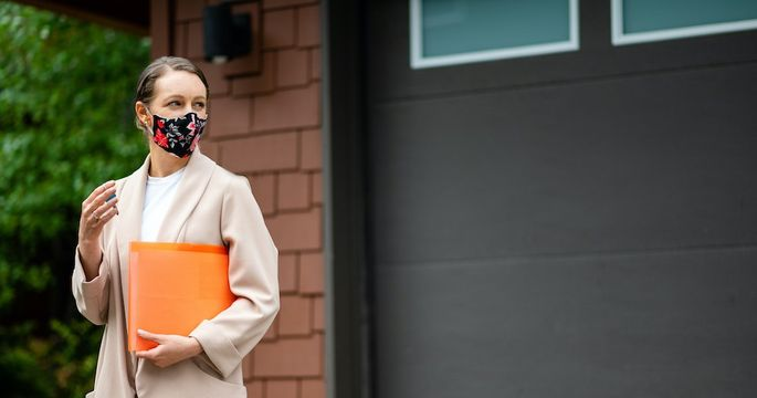 Realtor with a protective face mask
