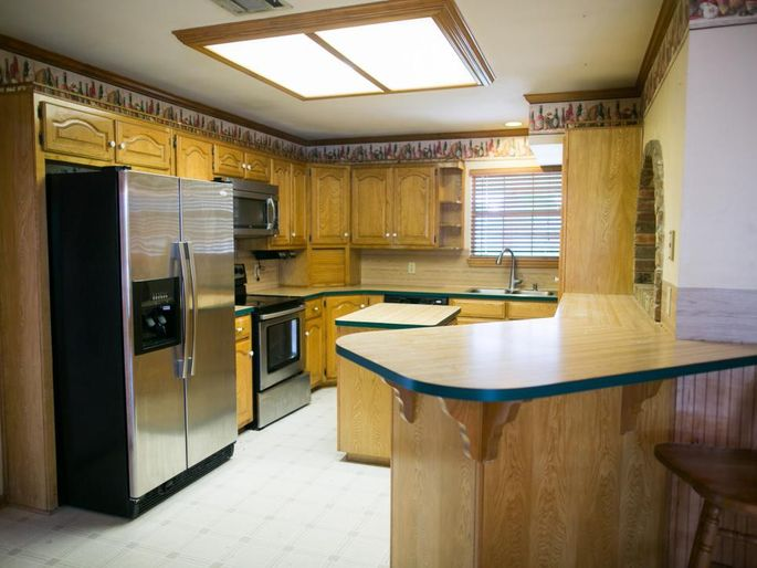 Something's gotta go in this cramped kitchen with the low ceiling.