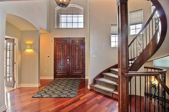 Two-story entryway with curved staircase