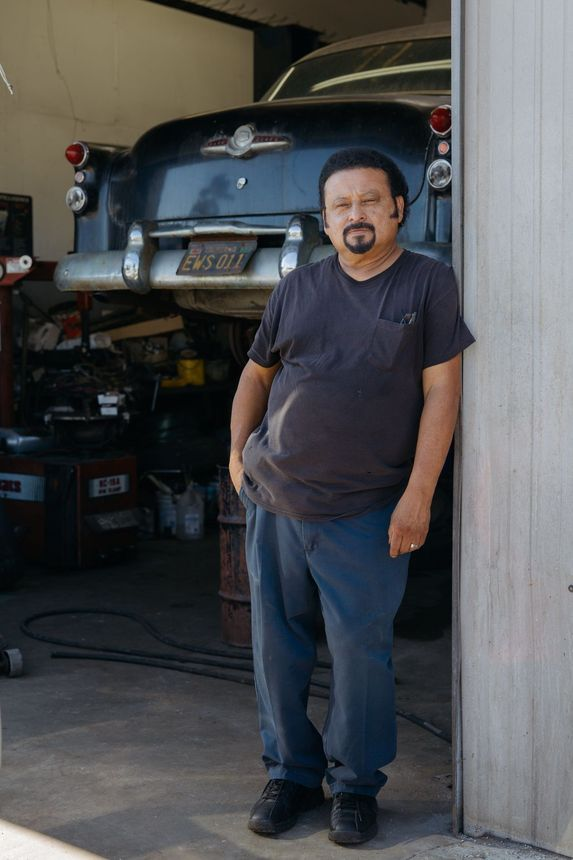 Nelson Gomez runs an auto-repair shop in Venice but can't afford to live there.