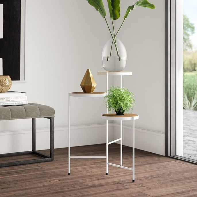 Display houseplants in a stylish way on a tiered stand.