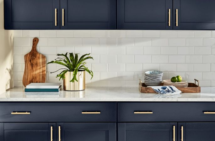 Try a chic navy blue like Blue Endeavor on your kitchen cabinets.