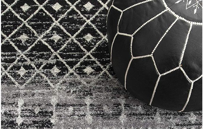 Try styling this rug with a leather Moroccan pouf.