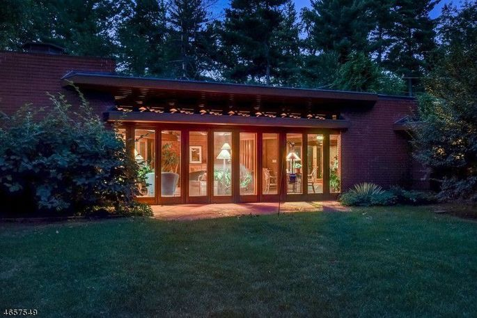 The home is nestled away from the street, on a wooded half-acre.